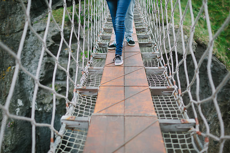 Young Couple Visiting Rope Bridge Northern Ireland by HEX. for Stocksy United