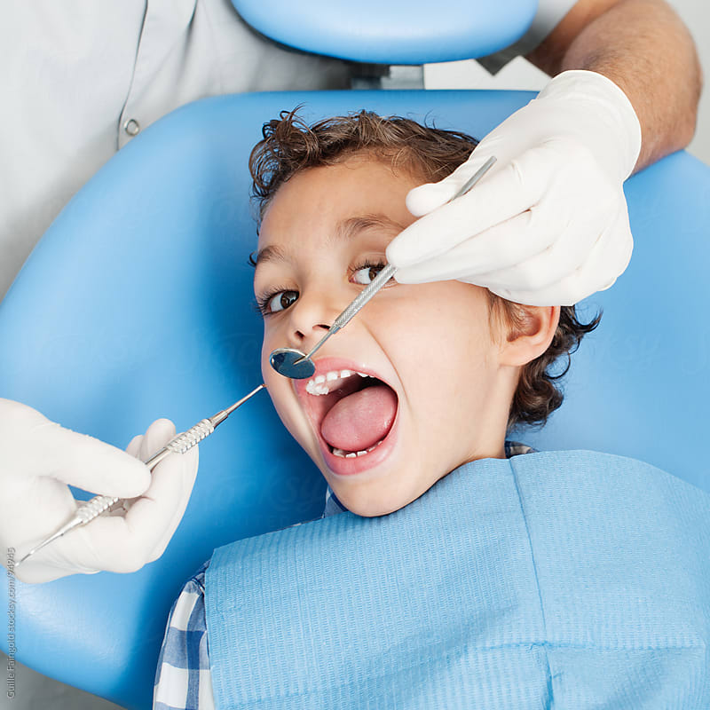 At the dentist's office. Child at dentist surgery. by Guille Faingold for Stocksy United