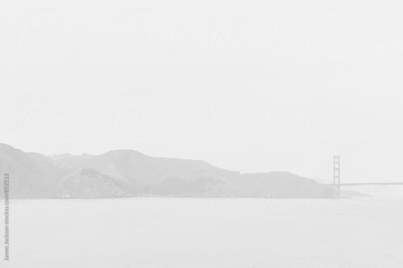 Foggy San Francisco Bay and part of the Golden Gate Bridge by James Jackson for Stocksy United