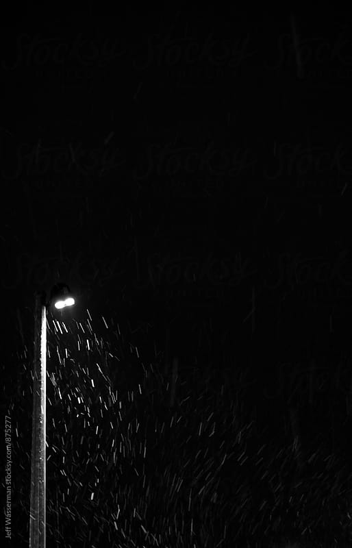 Blowing Snow at Night Illuminated by Streetlight by Studio Six for Stocksy United