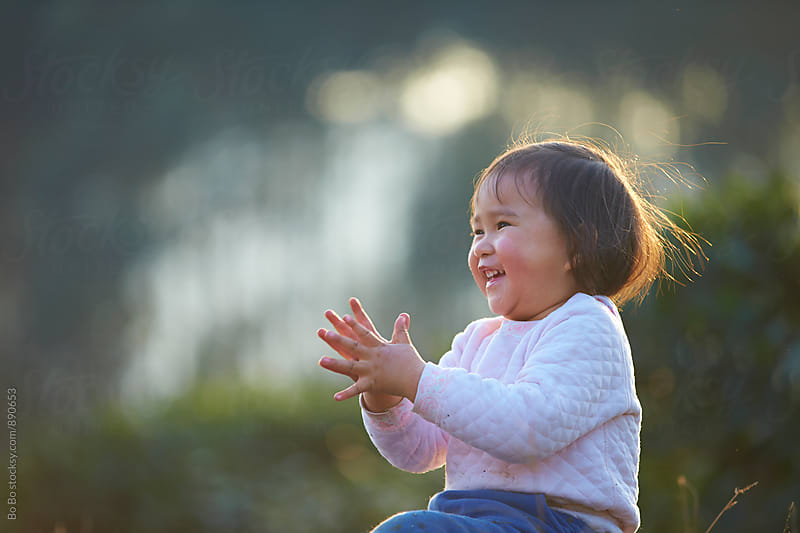 lovely little asian girl outdoor by cuiyan Liu for Stocksy United