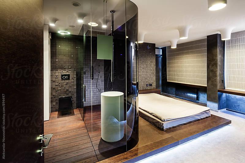 Modern bedroom and bathroom in contemporary interior by Aleksandar Novoselski for Stocksy United