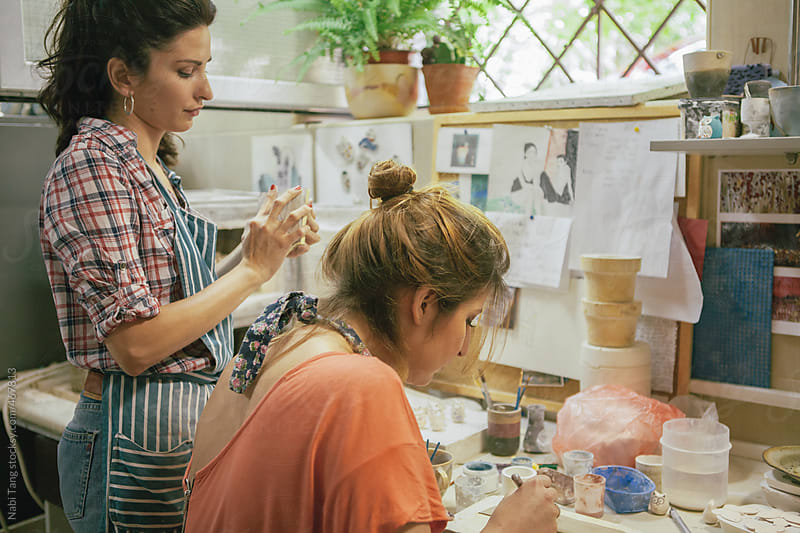 Friends working together in ceramic studio by Nabi Tang for Stocksy United