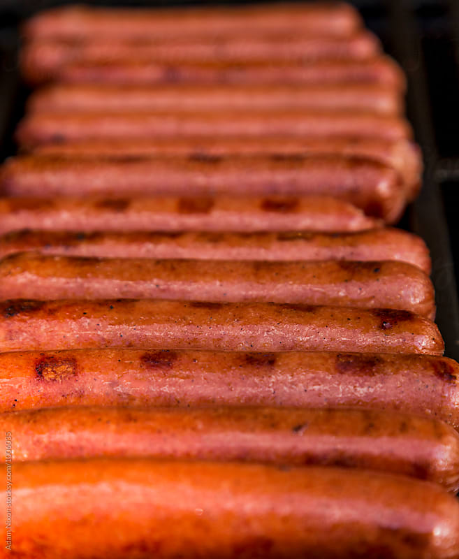 Hot Dogs on the grill by Adam Nixon for Stocksy United