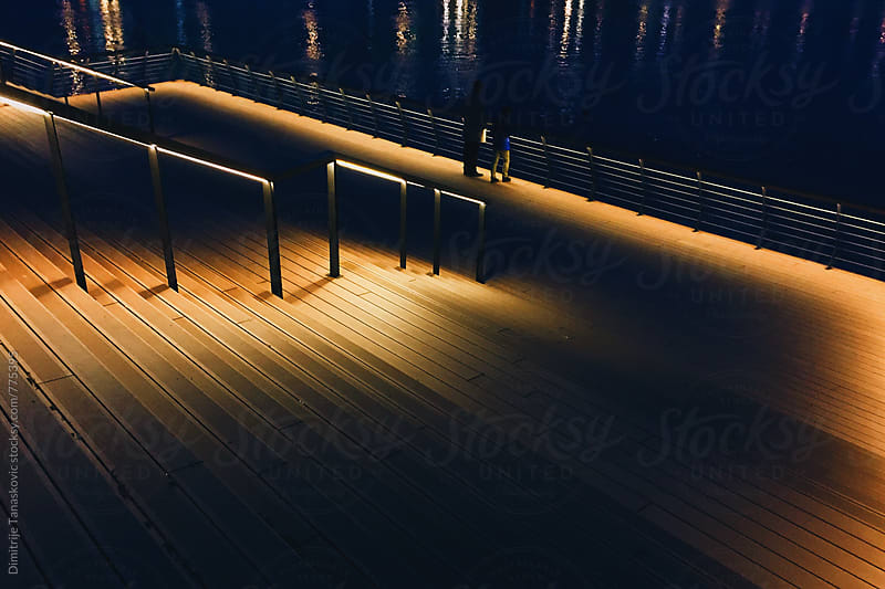 Stairs on the pier in the night by Dimitrije Tanaskovic for Stocksy United