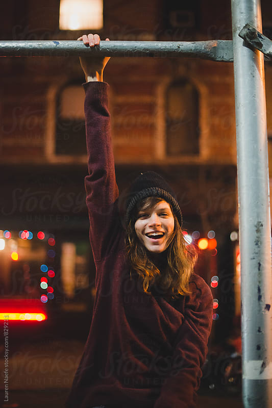 Fun young woman having fun in the city by Lauren Naefe for Stocksy United