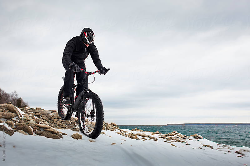 Extreme Sport Winter Mountain Bike Race In Snow on Fat Bike by JP Danko for Stocksy United
