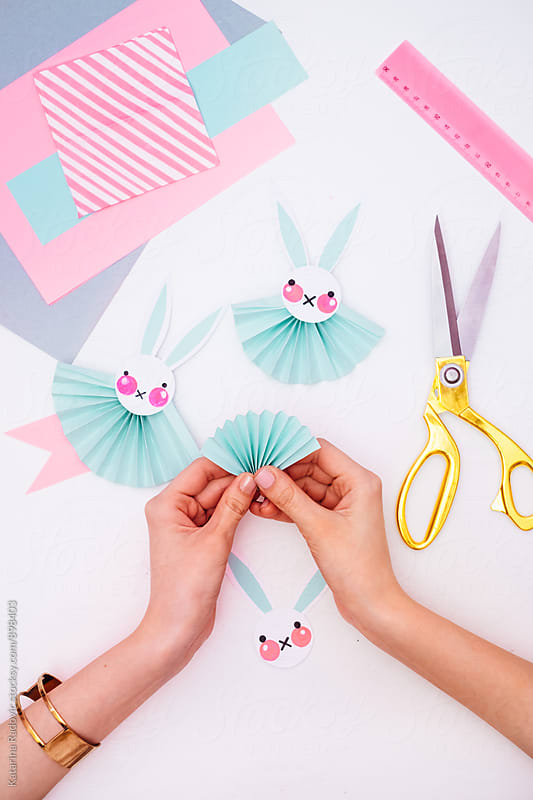 Woman Making Easter Bunny Rosettes As an Easter Decoration  by Katarina Radovic for Stocksy United