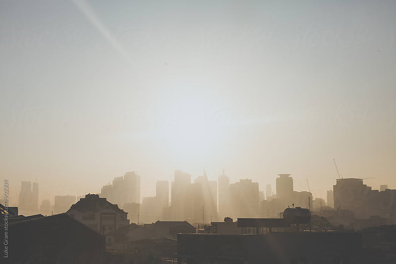 Sunrise over Manila by Luke Gram for Stocksy United
