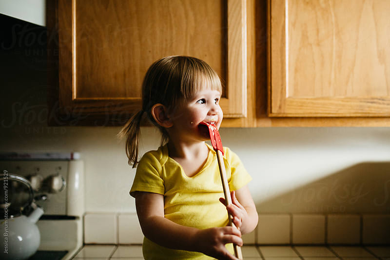 Toddler Child Licking Spatula by Jessica Byrum for Stocksy United