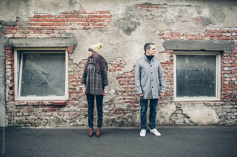 Young Man and Woman Standing on the Street  by Mosuno for Stocksy United