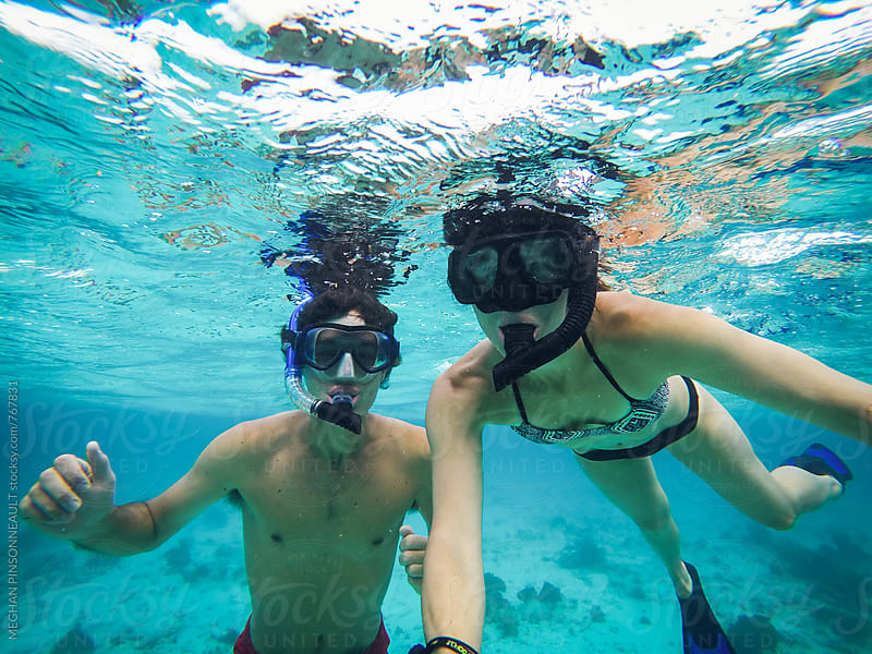 Couple Snorkling in Clear Blue Waters Above a Shipwreck by MEGHAN PINSONNEAULT for Stocksy United