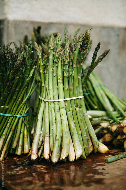 Asparagus for sale on a market stall. by kkgas for Stocksy United
