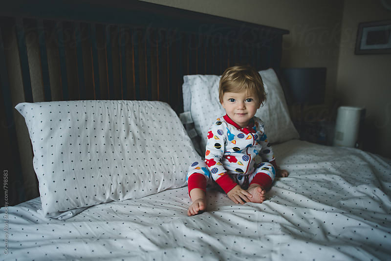 Boy in Mama's Bed by Courtney Rust for Stocksy United