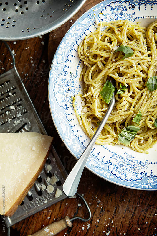 A bowl of pasta and pesto sauce by James Ross for Stocksy United