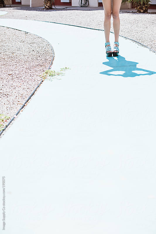 Blue pathway and girls legs by Image Supply Co for Stocksy United