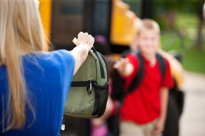 School Bus: Boy Forgot His Lunchbox by Sean Locke for Stocksy United