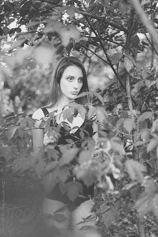 Young woman in the forest surrounded by nature. by Aleksandra Kovac for Stocksy United