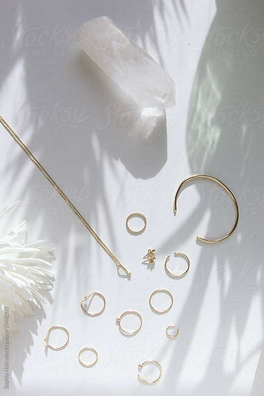 Jewelry with white props in light by Sophia Hsin for Stocksy United