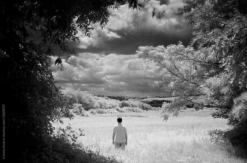 Man in infrared landscape by Cosma Andrei for Stocksy United