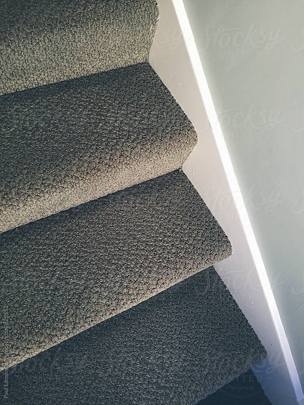 Close up carpeted stairs by Paul Edmondson for Stocksy United