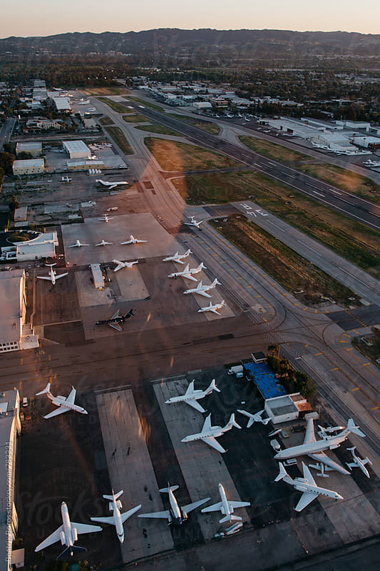 Small American airport with many small planes seen from above by Beatrix Boros for Stocksy United