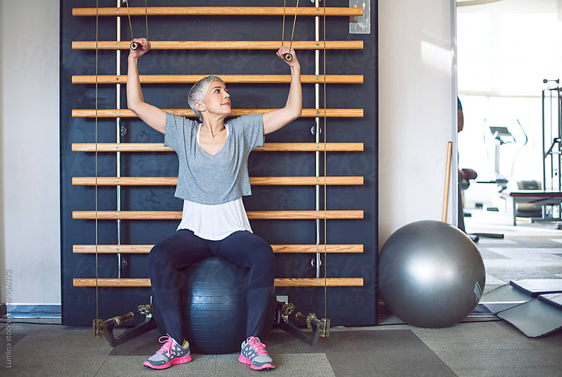 Woman Doing Exercise on the Kinesis in the Gym by Lumina for Stocksy United
