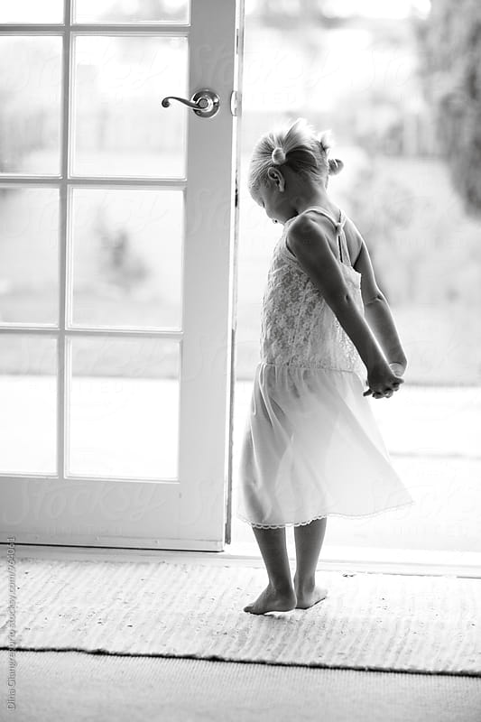 Girl In White Lace Dress In Front of White French Doors by Dina Giangregorio for Stocksy United