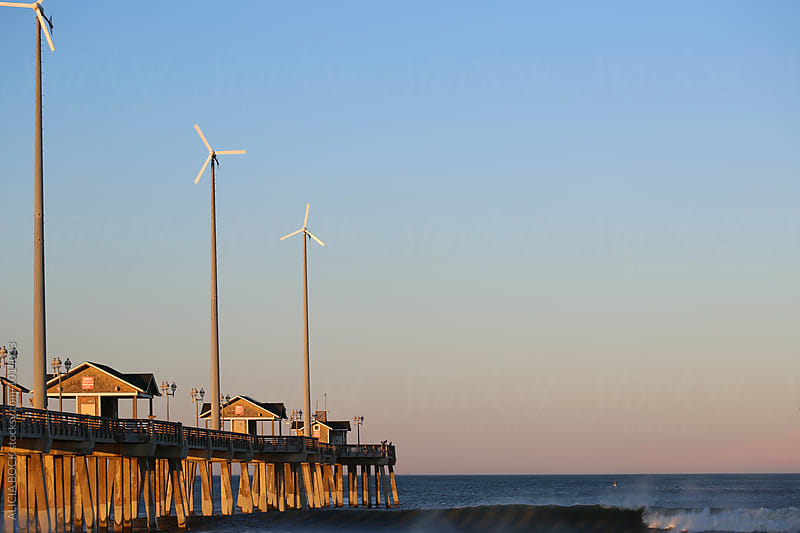 Wind Turbines On A North Carolina Pier by ALICIA BOCK for Stocksy United