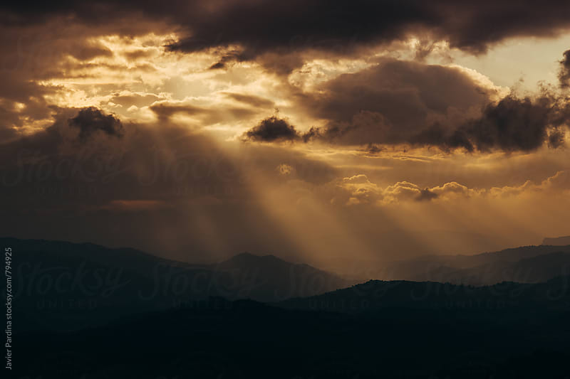storm clouds on the sky at sunset by Javier Pardina for Stocksy United