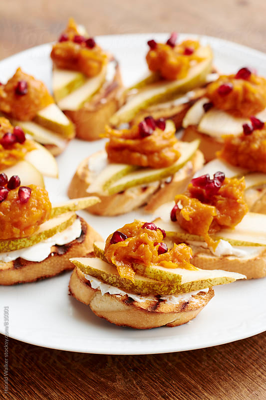 Bruschetta with Pears, Pumpkin and Pomegranate by Harald Walker for Stocksy United