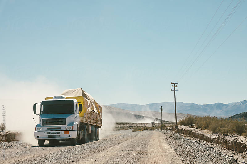 A truck along a dusty dirt road by michela ravasio for Stocksy United