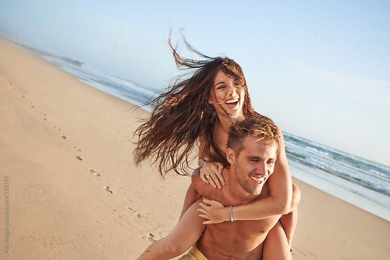 Romantic Couple on the Beach by Aila Images for Stocksy United