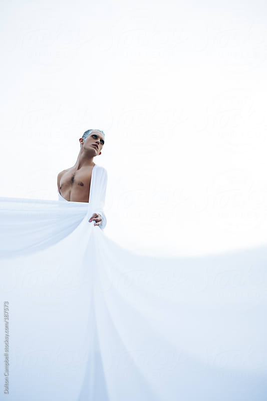 Man standing representing winter by Dalton Campbell for Stocksy United