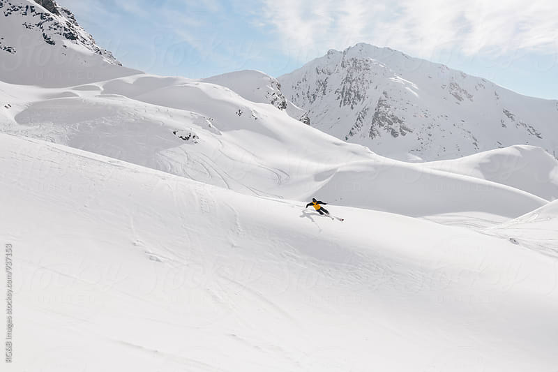 Free skier riding downhill in the mountains by RG&B Images for Stocksy United