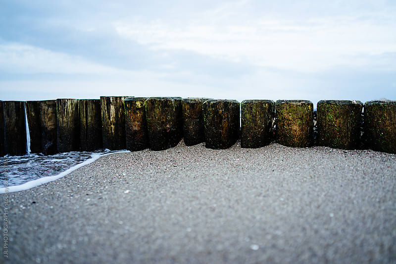 Wooden groyne on beach by J.R. PHOTOGRAPHY for Stocksy United