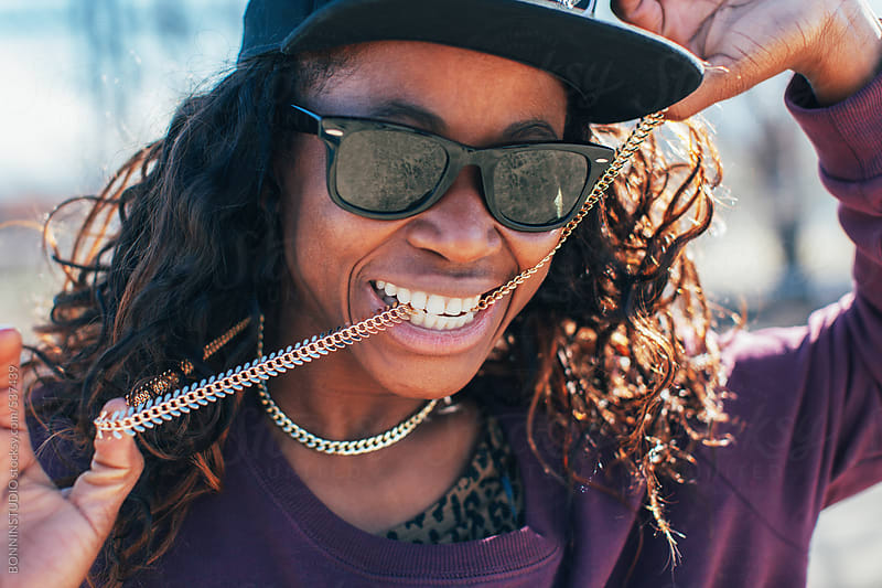 African american hip-hop style woman hanging out on the street.  by BONNINSTUDIO for Stocksy United