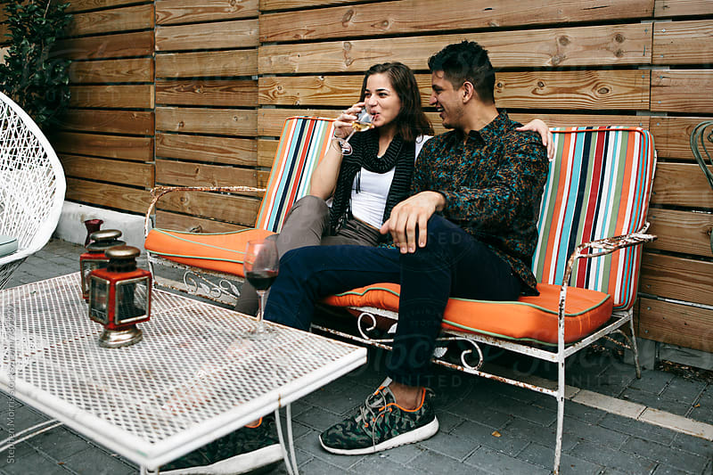 Young couple sitting by Stephen Morris for Stocksy United