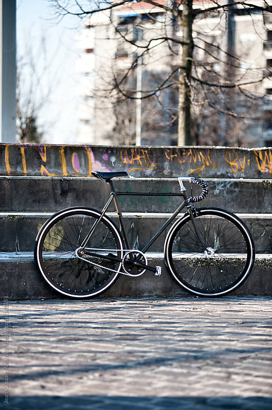 Fixed gear bike in a suburb area by Jean-Claude Manfredi for Stocksy United