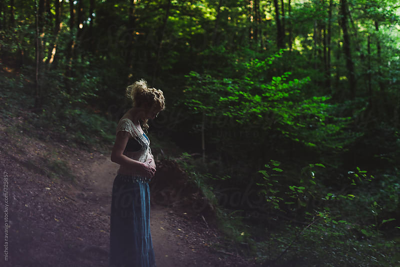 Pregnant woman in the forest by michela ravasio for Stocksy United