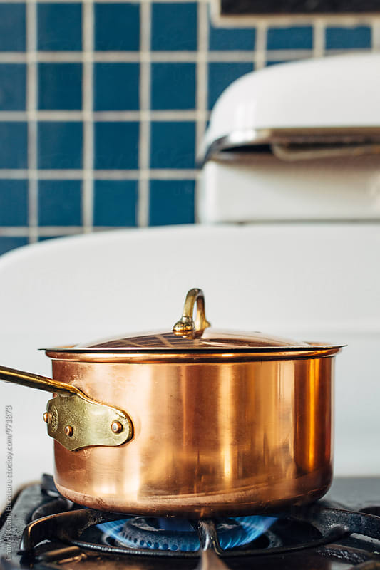 Copper pot on a retro stove by Gabriel (Gabi) Bucataru for Stocksy United