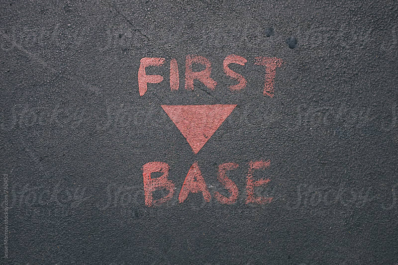 first base painted on concrete  by Jesse Morrow for Stocksy United