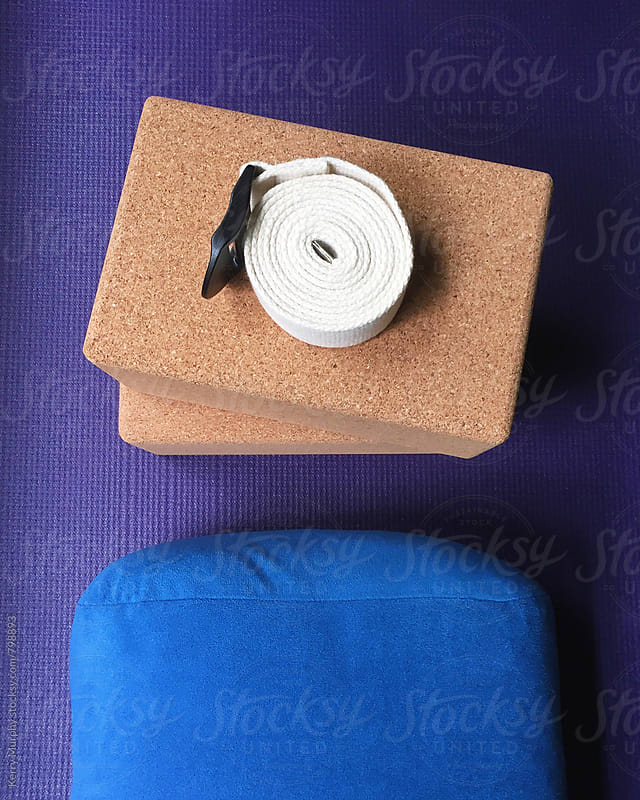 Yoga block, strap, bolster and mat from above by Kerry Murphy for Stocksy United