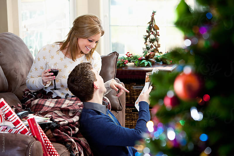 Christmas: Couple Doing Holiday Catalog Shopping by Sean Locke for Stocksy United