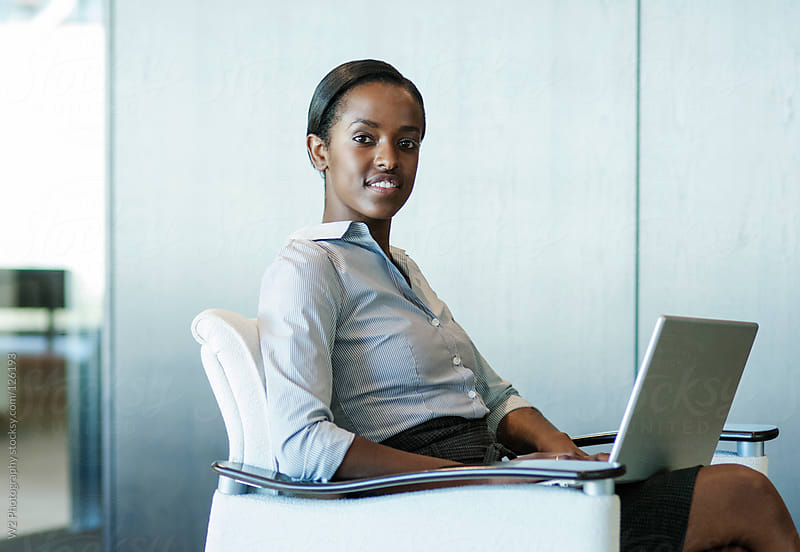 Young business woman  working on a laptop by W2 Photography for Stocksy United
