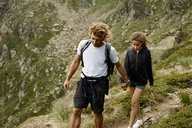 Family summer hike in the Pyrenees mountains by Miquel Llonch for Stocksy United