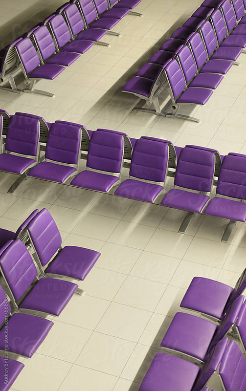 Purple chairs in row in waiting room. by Audrey Shtecinjo for Stocksy United