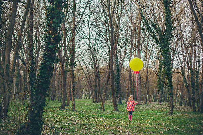 Girl Holding a Big Yellow Balloon by Lumina for Stocksy United
