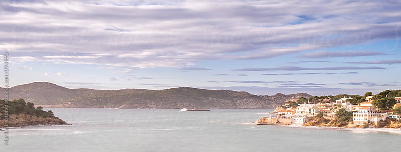 View of Sant Elm village and Dragonera Island in the background by Marilar Irastorza for Stocksy United