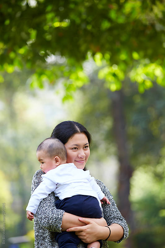 young mother and her baby by Bo Bo for Stocksy United